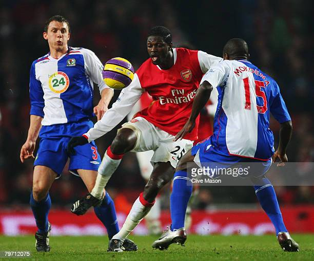 Emmanuel Adebayor of Arsenal takes on Aaron Mokoena and Stephen Warnock of Blackburn Rovers during the Barclays Premier League match between Arsenal...