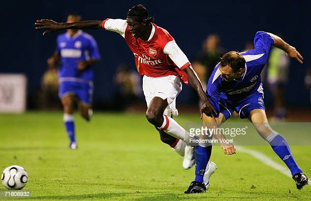 Emmanuel Adebayor of Arsenal tussels for the ball with Jens Nowotny of Zagreb during the UEFA Champions League Qualification third round match...