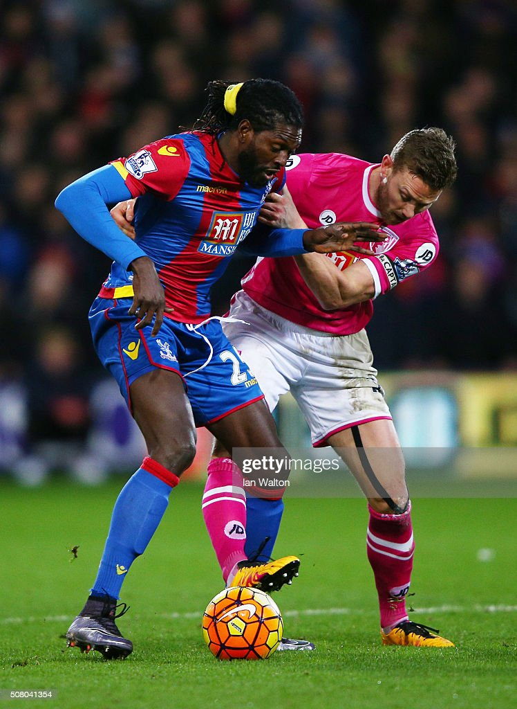 Emmanuel Adebayor of Crystal Palace and Simon Francis of Bournemouth compete for the ball during the Barclays Premier League match between Crystal Palace and A.F.C. Bournemouth at Selhurst Park on February 2, 2016 in London, England.
