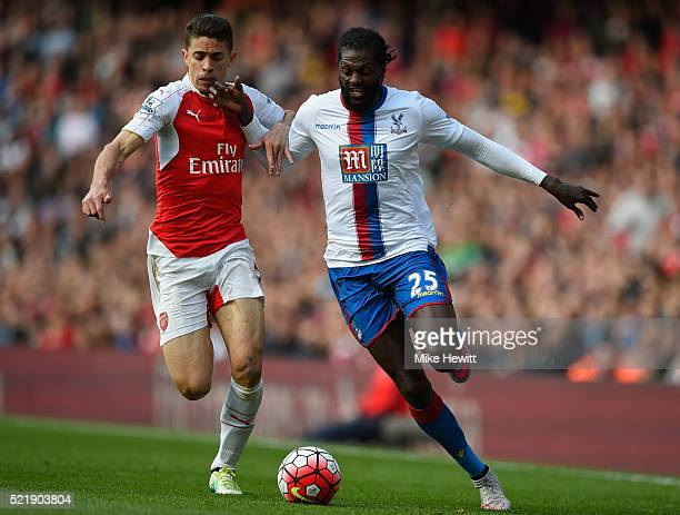 Emmanuel Adebayor of Crystal Palace is challenged by Gabriel Paulista of Arsenal during the Barclays Premier League match between Arsenal and Crystal...