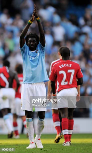 Emmanuel Adebayor of Manchester City applauds the fans at the end of the Barclays Premier League match between Manchester City and Arsenal at the...
