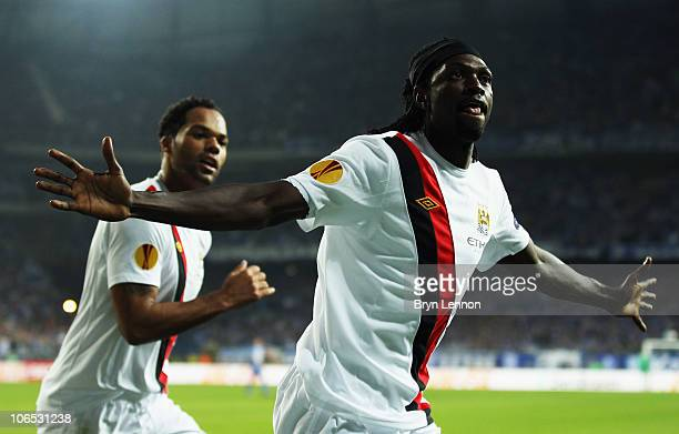 Emmanuel Adebayor of Manchester City celebrates scoring during the UEFA Europa League Group A match between KKS Lech Poznan and Manchester City at...