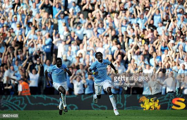 Emmanuel Adebayor of Manchester City celebrates with teammate Kolo Toure during the Barclays Premier League match between Manchester City and Arsenal...