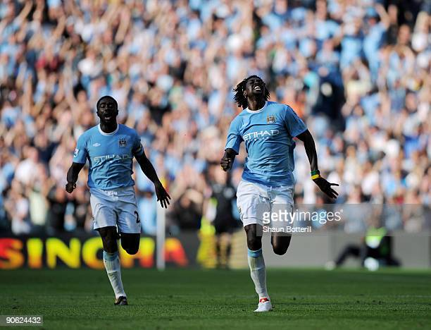 Emmanuel Adebayor of Manchester City celebrates with teammate Kolo Toure after scoring during the Barclays Premier League match between Manchester...
