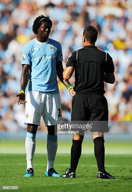 Emmanuel Adebayor of Manchester City is lectured by Referee Mark Clattenburg after fouling Francesc Fabregas of Arsenal during the Barclays Premier...