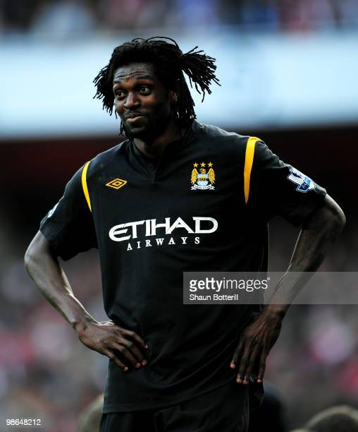 Emmanuel Adebayor of Manchester City looks on during the Barclays Premier League match between Arsenal and Manchester City at the Emirates Stadium on...