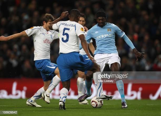 Emmanuel Adebayor of Manchester City shoots past Manuel Arboleda of KKS Lech Poznan to score the opening goal during the UEFA Europa League Group A...