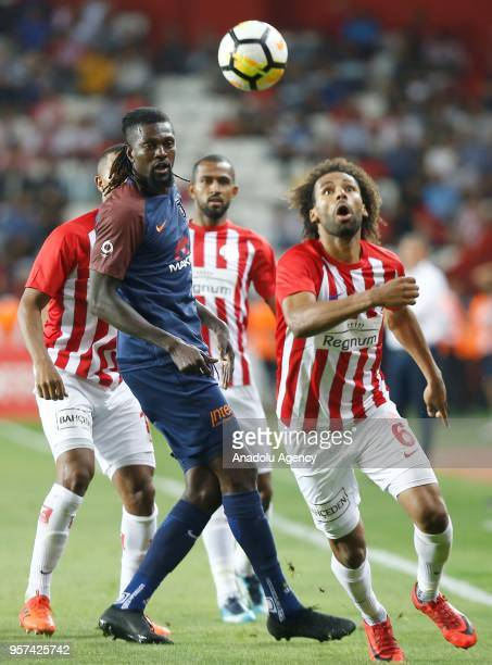 Emmanuel Adebayor of Medipol Basaksehir in action against Nazim Sangare of Antalyaspor during the Turkish Super Lig match between Antalyaspor and...