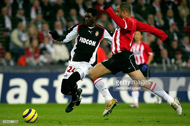 Emmanuel Adebayor of Monaco battles with Alex of PSV during the UEFA Champions League first knockout round first leg match between PSV Eindhoven and...