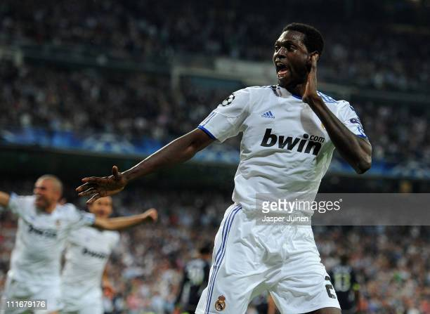 Emmanuel Adebayor of Real Madrid celebrates scoring his second goal during the UEFA Champions League quarter final first leg match between Real...