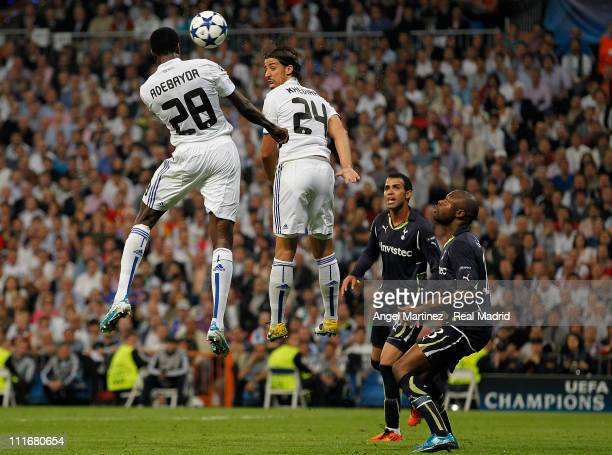 Emmanuel Adebayor of Real Madrid heads the ball to score his side second goal during the UEFA Champions League quarter final first leg match between...