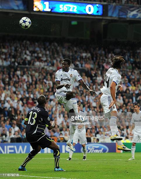 Emmanuel Adebayor of Real Madrid scores his second goal past William Gallas of Tottenham Hotspur during the UEFA Champions League quarter final first...