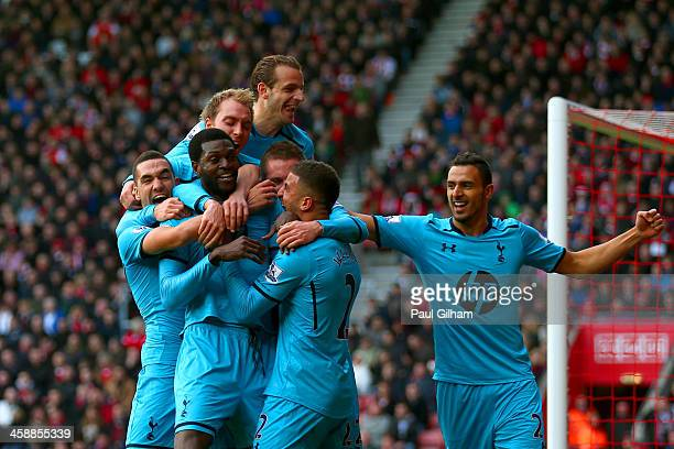 Emmanuel Adebayor of Spurs celebrates with teammates after scoring his team's third goal during the Barclays Premier League match between Southampton...