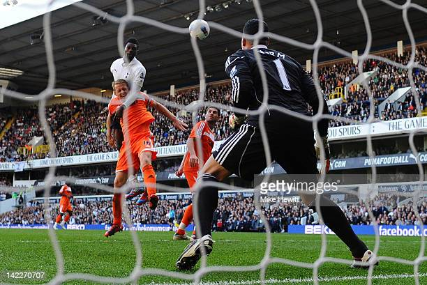 Emmanuel Adebayor of Spurs goes up to head his second goal and Spurs third during the Barclays Premier League match between Tottenham Hotspur and...