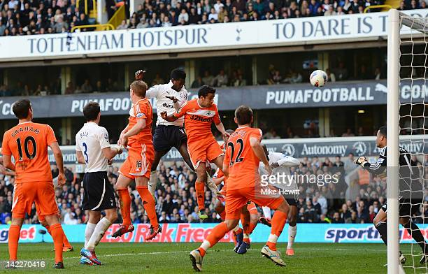 Emmanuel Adebayor of Spurs heads in their second goal during the Barclays Premier League match between Tottenham Hotspur and Swansea City at White...