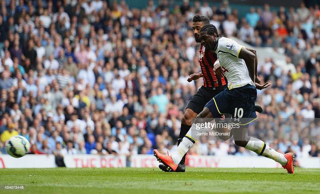 Emmanuel Adebayor of Spurs scores his goal during the Barclays Premier League match between Tottenham Hotspur and Queens Park Rangers at White Hart Lane on August 24, 2014 in London, England.