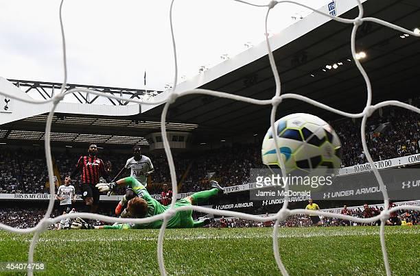 Emmanuel Adebayor of Spurs scores his goal during the Barclays Premier League match between Tottenham Hotspur and Queens Park Rangers at White Hart...