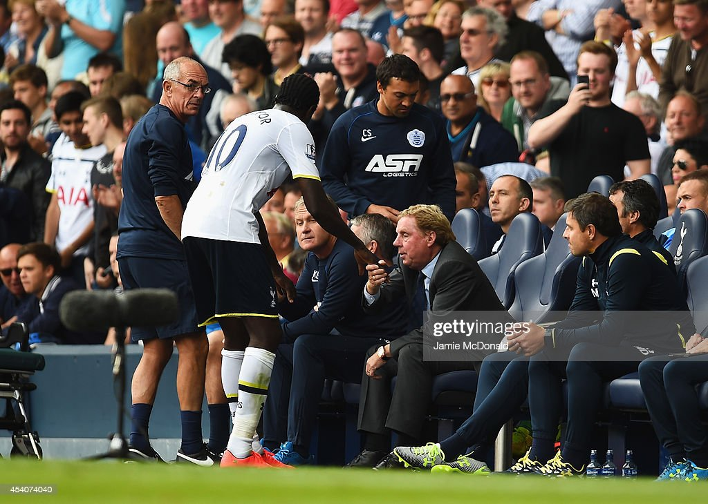 Emmanuel Adebayor of Spurs shakes hands with Harry Redknapp, the QPR manager during the Barclays Premier League match between Tottenham Hotspur and Queens Park Rangers at White Hart Lane on August 24, 2014 in London, England.
