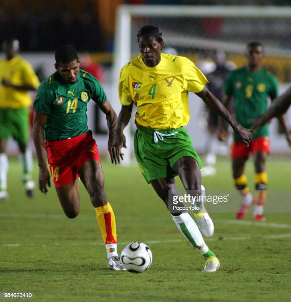 Emmanuel Adebayor of Togo and Alioum Saidou of Cameroon in action during the Africa Cup of Nations Group B match between Cameroon and Togo at the...