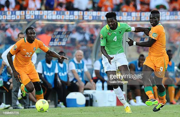 Emmanuel Adebayor of Togo and Cheick Tiote of Ivory Coast tussle for the ball during the 2013 Orange African Cup of Nations match between Ivory Coast...