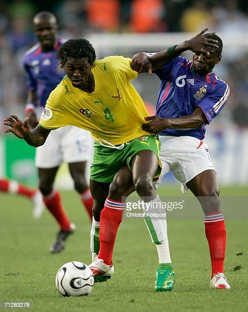 Emmanuel Adebayor of Togo and Claude Makelele of France battle for the ball during the FIFA World Cup Germany 2006 Group G match between Togo and...