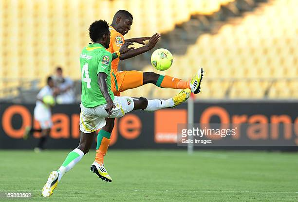Emmanuel Adebayor of Togo and Max Gradel of Ivory Coast compete for the ball during the 2013 Orange African Cup of Nations match between Ivory Coast...