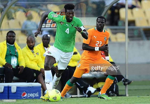 Emmanuel Adebayor of Togo in action against Emmanuel Eboue during the 2013 Orange African Cup of Nations match between Ivory Coast and Togo at Royal...