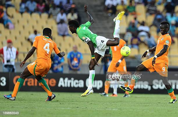 Emmanuel Adebayor of Togo in action against Kolo Toure and Cheick Tiote of Ivory Coast during the 2013 Orange African Cup of Nations match between...