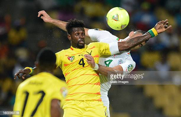 AFRICA JANUARY 26 Emmanuel Adebayor of Togo is challenge by Essaid Belkalem of Algeria during the 2013 African Cup of Nations match between Togo and...