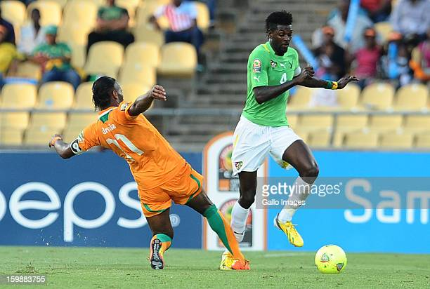 Emmanuel Adebayor of Togo is challenged by Didier Drogba of Ivory Coast during the 2013 Orange African Cup of Nations match between Ivory Coast and...