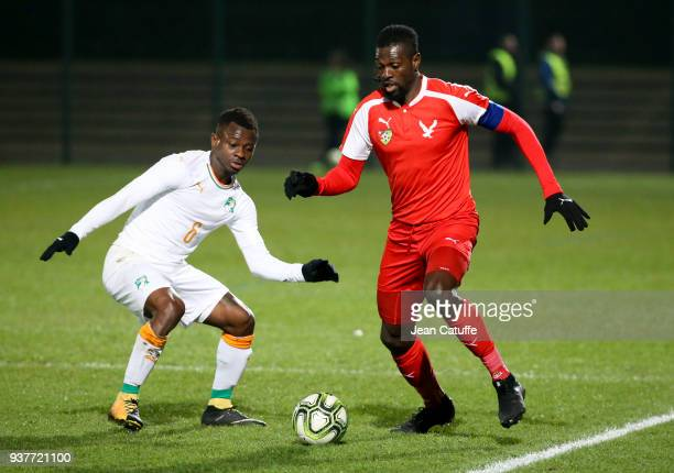 Emmanuel Adebayor of Togo Jean Michael Seri of Ivory Coast during the international friendly match between Togo and Ivory Coast at Stade Pierre...