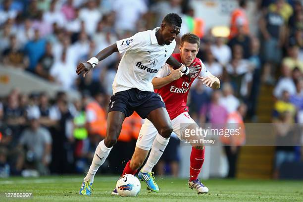 Emmanuel Adebayor of Tottenham Hotspur and Aaron Ramsey of Arsenal tussle for the ball during the Barclays Premier League match between Tottenham...
