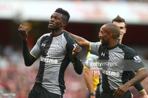 Emmanuel Adebayor of Tottenham Hotspur celebrates his goal with teammate Jermain Defoe during the Barclays Premier league match between Arsenal and...