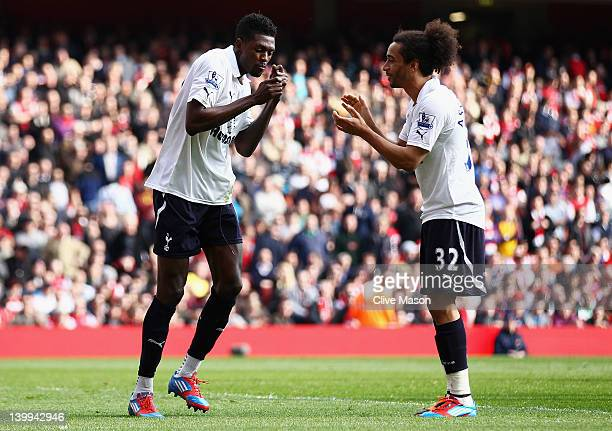 Emmanuel Adebayor of Tottenham Hotspur celebrates his penalty with Benoit AssouEkotto during the Barclays Premier League match between Arsenal and...