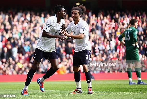 Emmanuel Adebayor of Tottenham Hotspur celebrates his penalty with Benoit AssouEkotto during the Barclays Premier League match between Arsenal and...