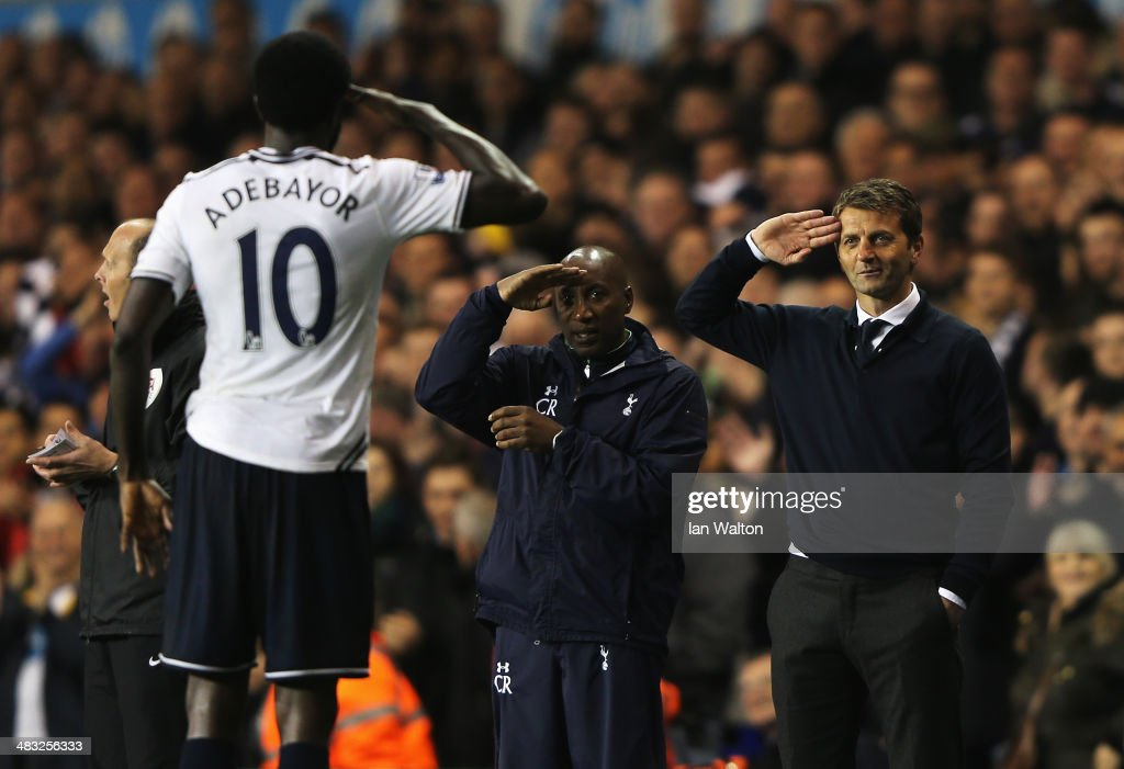 Emmanuel Adebayor of Tottenham Hotspur celebrates scoring his second goal with Tim Sherwood (R), manager of Tottenham Hotspur and Chris Ramsey during the Barclays Premier League match between Tottenham Hotspur and Sunderland at White Hart Lane on April 7, 2014 in London, England.