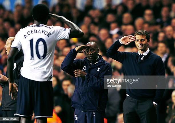Emmanuel Adebayor of Tottenham Hotspur celebrates scoring his second goal with Tim Sherwood , manager of Tottenham Hotspur and Chris Ramsey during...