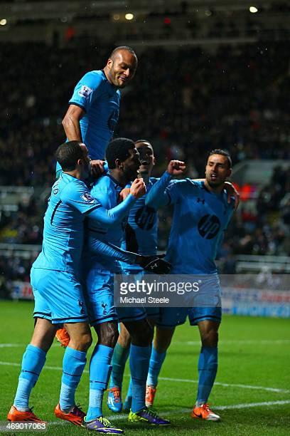 Emmanuel Adebayor of Tottenham Hotspur celebrates scoring their third goal with team mate sduring the Barclays Premier League match between Newcastle...