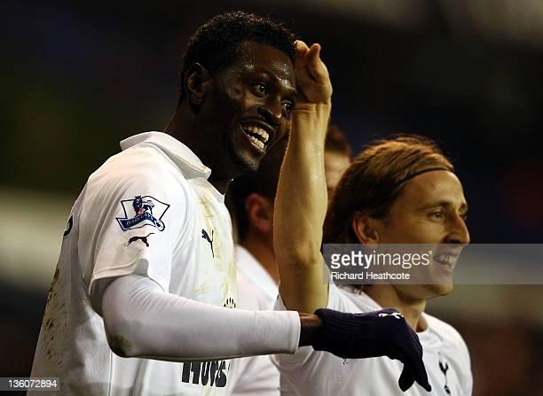Emmanuel Adebayor of Tottenham Hotspur celebrates with teammate Luka Modric of Tottenham Hotspur after scoring the opening goal during the Barclays...