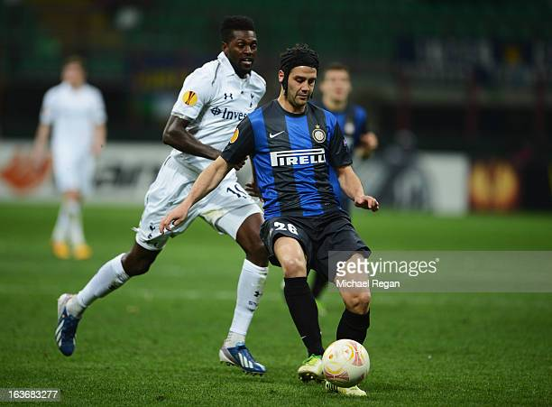 Emmanuel Adebayor of Tottenham Hotspur is beatne by Cristian Chivu of Inter Milan during UEFA Europa League Round of 16 second leg match between...