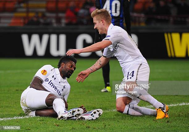Emmanuel Adebayor of Tottenham Hotspur is congratulated by team mate Lewis Holtby as he scores their first goal during UEFA Europa League Round of 16...