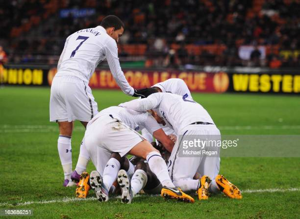 Emmanuel Adebayor of Tottenham Hotspur is congratulated by team mates as he scores their first goal during UEFA Europa League Round of 16 second leg...