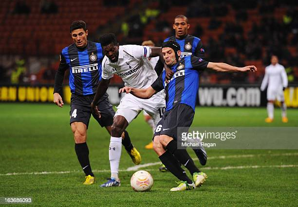 Emmanuel Adebayor of Tottenham Hotspur is foiled by Javier Zanetti and Cristian Chivu of Inter Milan during UEFA Europa League Round of 16 second leg...