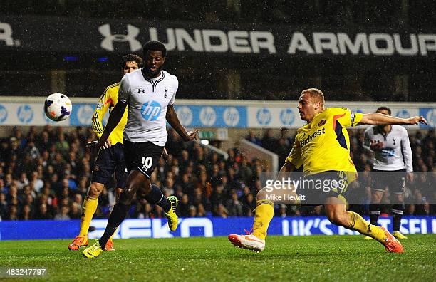 Emmanuel Adebayor of Tottenham Hotspur scores his team's first goal during the Barclays Premier League match between Tottenham Hotspur and Sunderland...