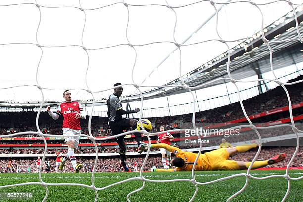 Emmanuel Adebayor of Tottenham Hotspur scores the opening goal past goalkeeper Wojciech Szczesny during the Barclays Premier league match between...