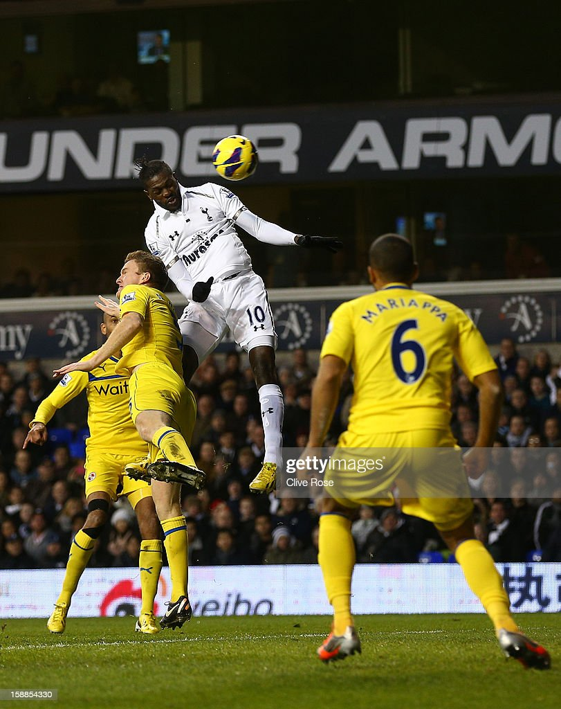 Emmanuel Adebayor of Tottenham Hotspur scores their second goal from a header during the Barclays Premier League match between Tottenham Hotspur and Reading at White Hart Lane on January 1, 2013 in London, England.