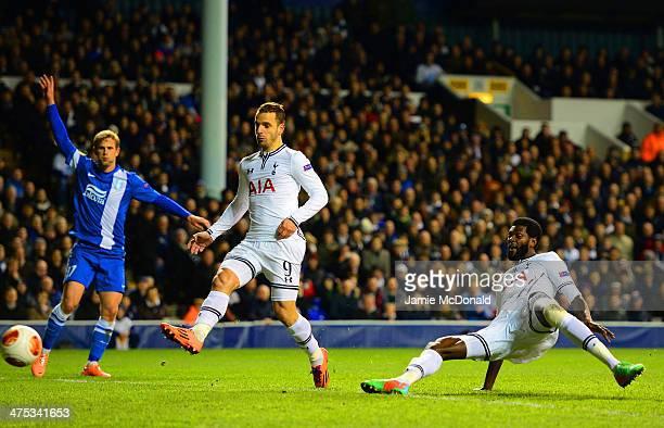 Emmanuel Adebayor of Tottenham Hotspur scores their second goal during the UEFA Europa League Round of 32 second leg match between Tottenham Hotspur...