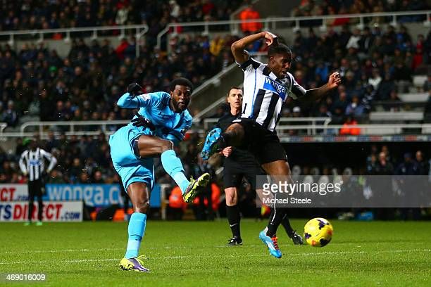 Emmanuel Adebayor of Tottenham Hotspur scores their third goal during the Barclays Premier League match between Newcastle United and Tottenham...
