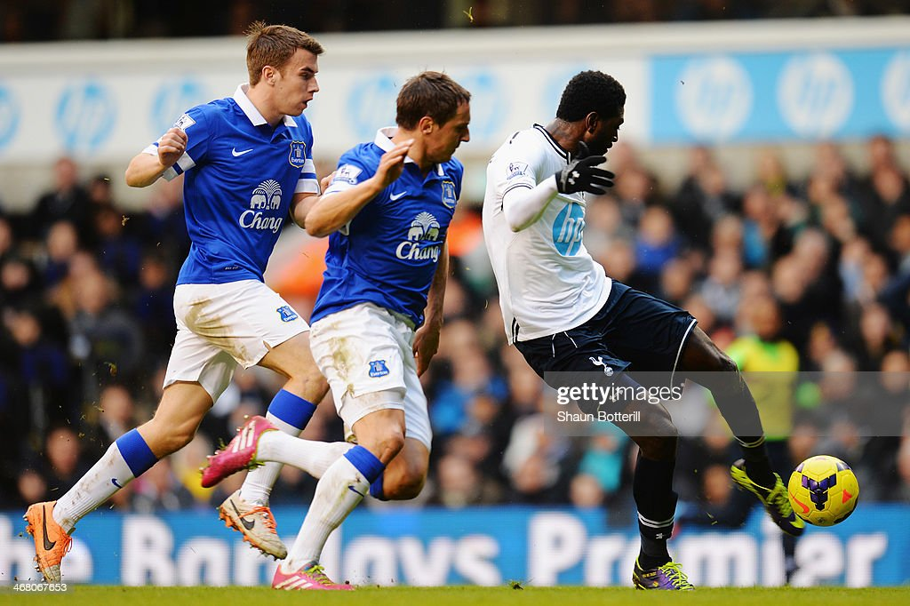 Emmanuel Adebayor (R) of Tottenham Hotspur shoots and scores during the Barclays Premier League match between Tottenham Hotspur and Everton at White Hart Lane on February 9, 2014 in London, England.