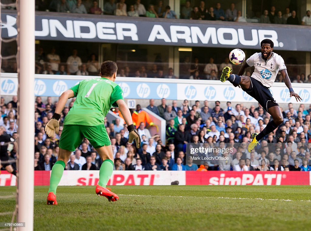 Emmanuel Adebayor of Tottenham Hotspur tries to control the ball as Wojciech Szczesny of Arsenal looks on during the Premier League match between Tottenham Hotspur and Arsenal at White Hart Lane on March 16, 2014 in London, England.